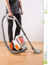 Cleaning With Vacuum Cleaner In Living Room Stock Photo ...