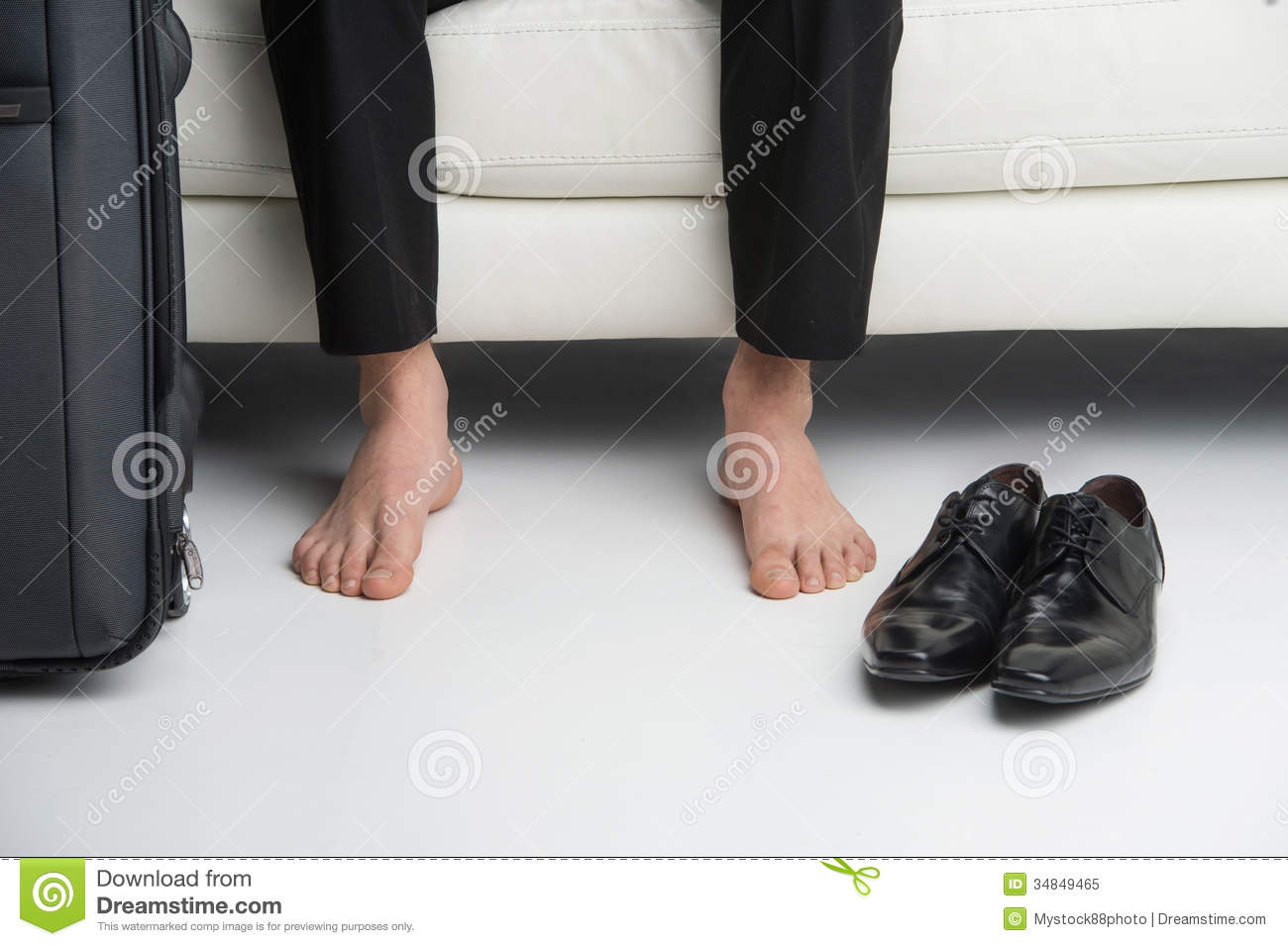 Close Up Of Bare Feet Of A Business Man Royalty Free