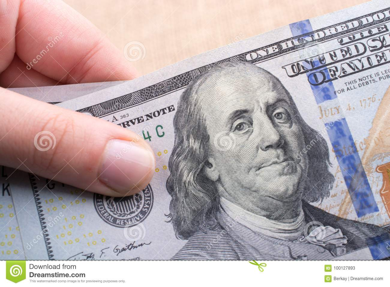 Close Up Of Benjamin Franklin Face On Us Dollar Stock