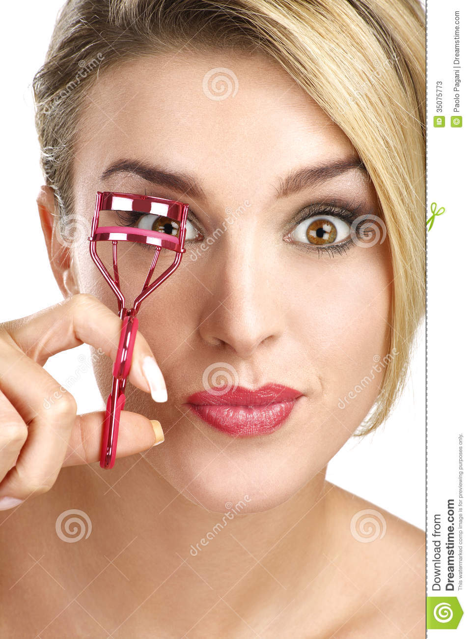 Close Up Of A Funny Beautiful Girl Using Eyelash Curler