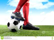 Close Of Soccer Player With Football Field Royalty