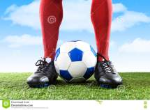 Close Legs Feet Football Player In Red Socks And Black