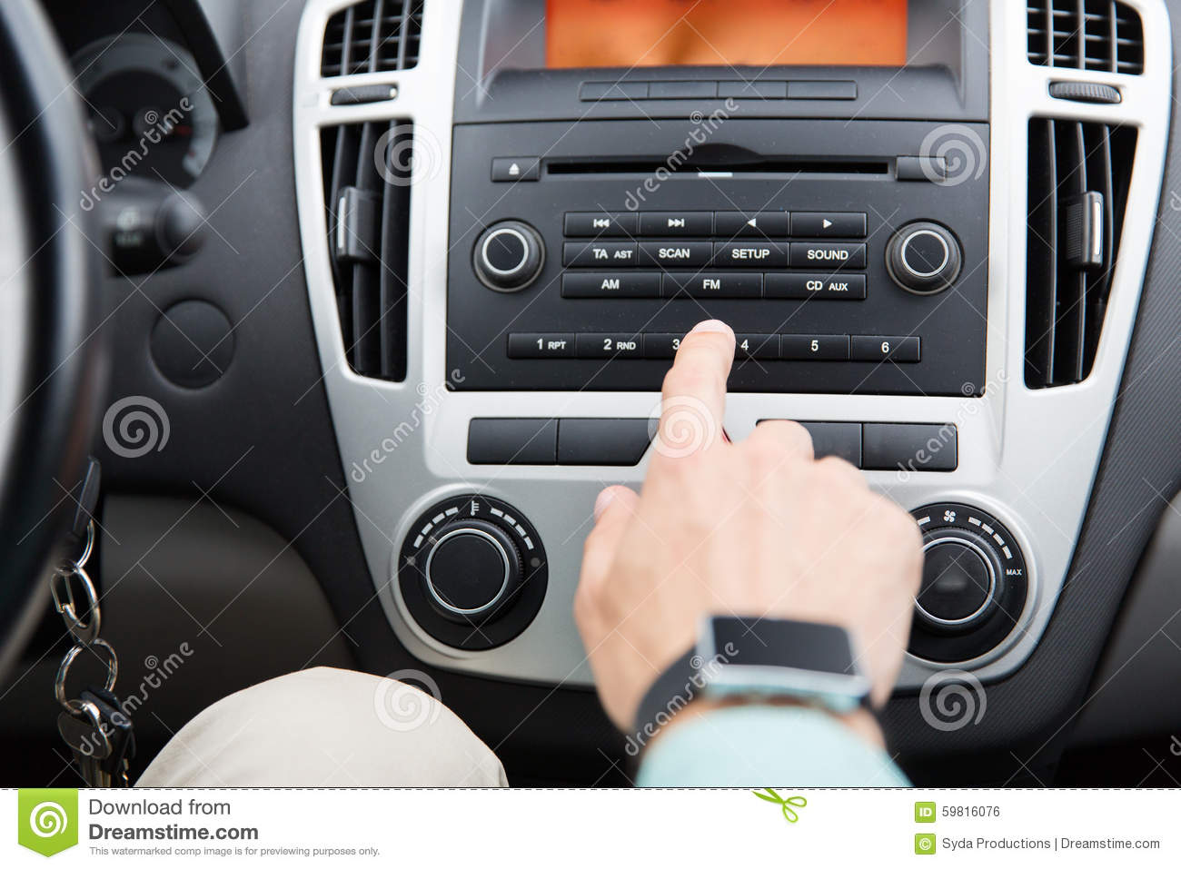 Close Up Of Male Hand Turning On Radio In Car Stock Photo