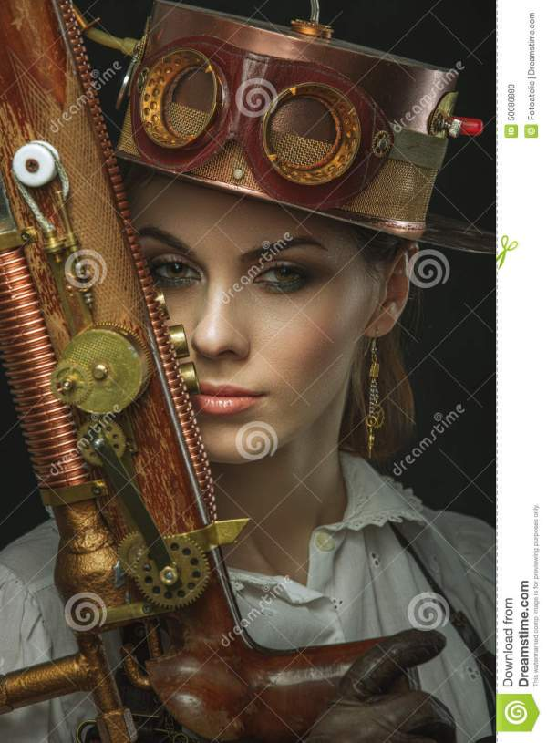 Close- Portrait Of Steampunk Girl With Gun In Hand