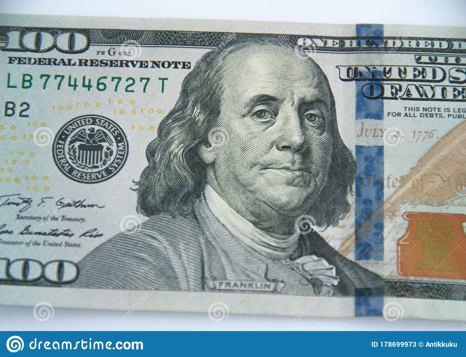 Close Up View Of A 100 Dollar Banknote On A White