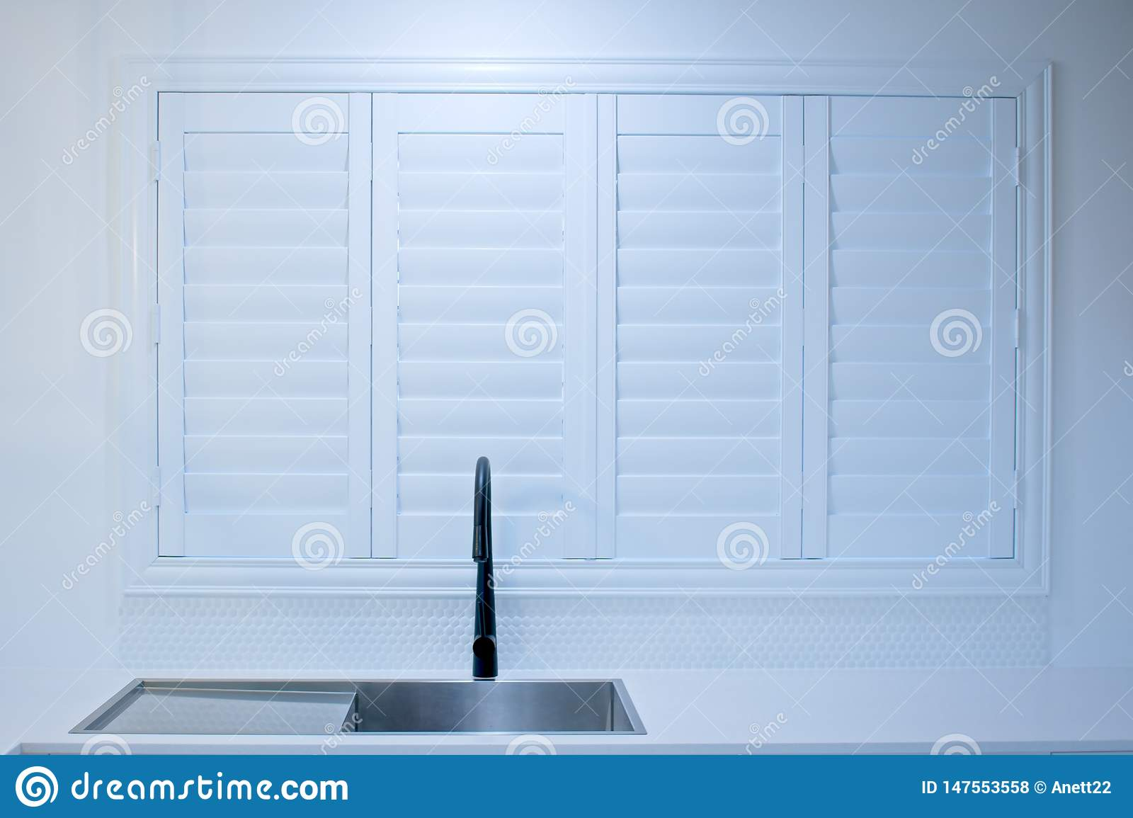 Closed Bifold Plantation Shutters In A Modern Kitchen Stock