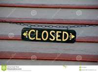 Closed Sign Across Stairs At Entrance Of Business Stock