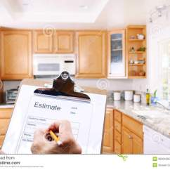 Kitchen Remodel Estimate Table With Storage Underneath Contractor Writing Royalty Free Stock Photo