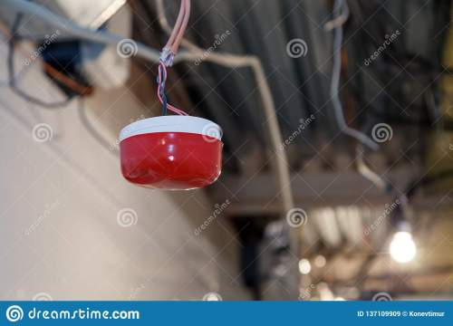 small resolution of closeup installation and repair of electric cable smoke detector fire alarm system before installing a stretch or suspended ceiling