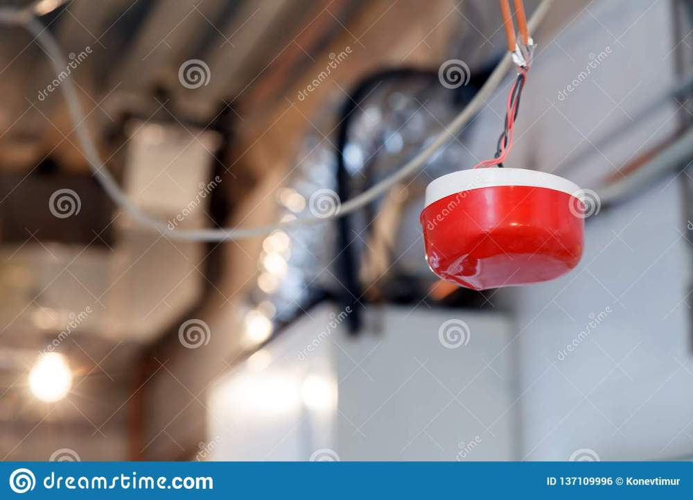 medium resolution of closeup installation and repair of electric cable smoke detector fire alarm system before installing a stretch or suspended ceiling