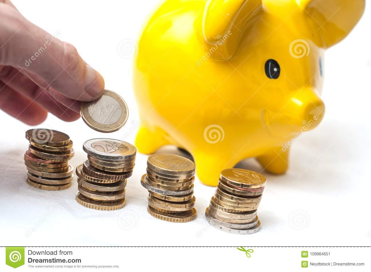 Man Counting Euro Coins In Hand And On Yellow Piggy B