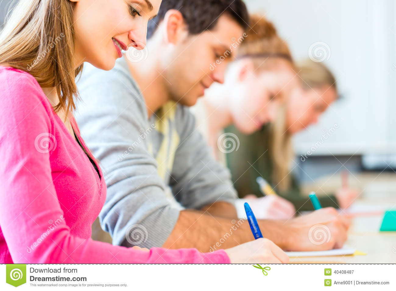 College Students Writing Test Or Exam Stock Photo