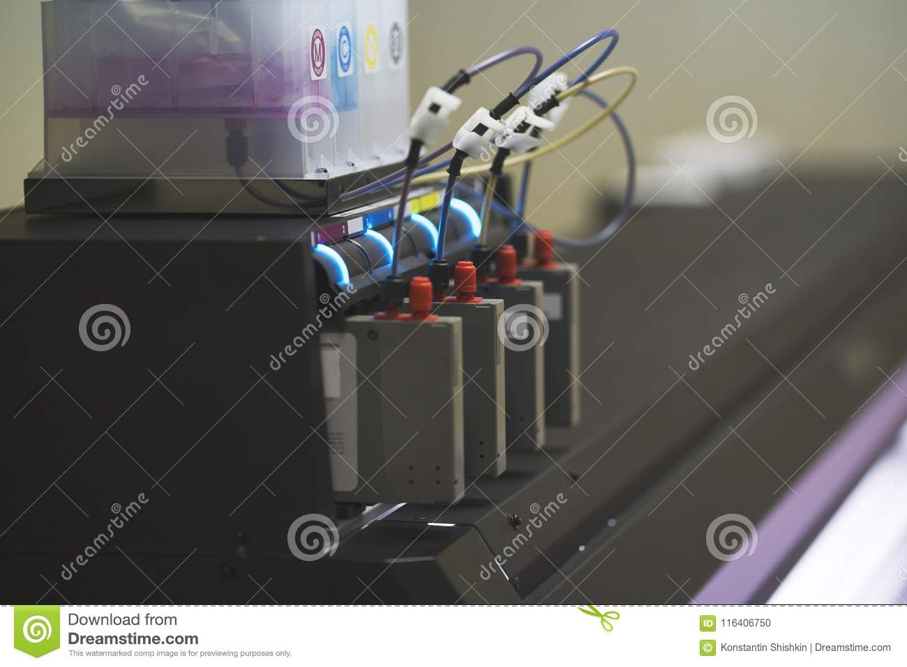 hight resolution of color ink cartridges inside professional printer in typography