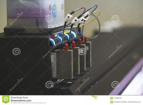 small resolution of color ink cartridges inside professional printer in typography