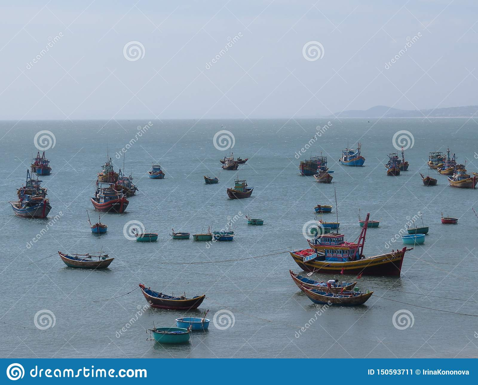 Colorful Fishing Boats Float In The Harbor Of Mui Ne. Vietnam Editorial Photo - Image of dock. nature: 150593711