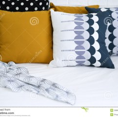 Beach Themed Sofa Pillows Two Tone Leather And Microfiber Colorful On A With White Brick Wall I Royalty
