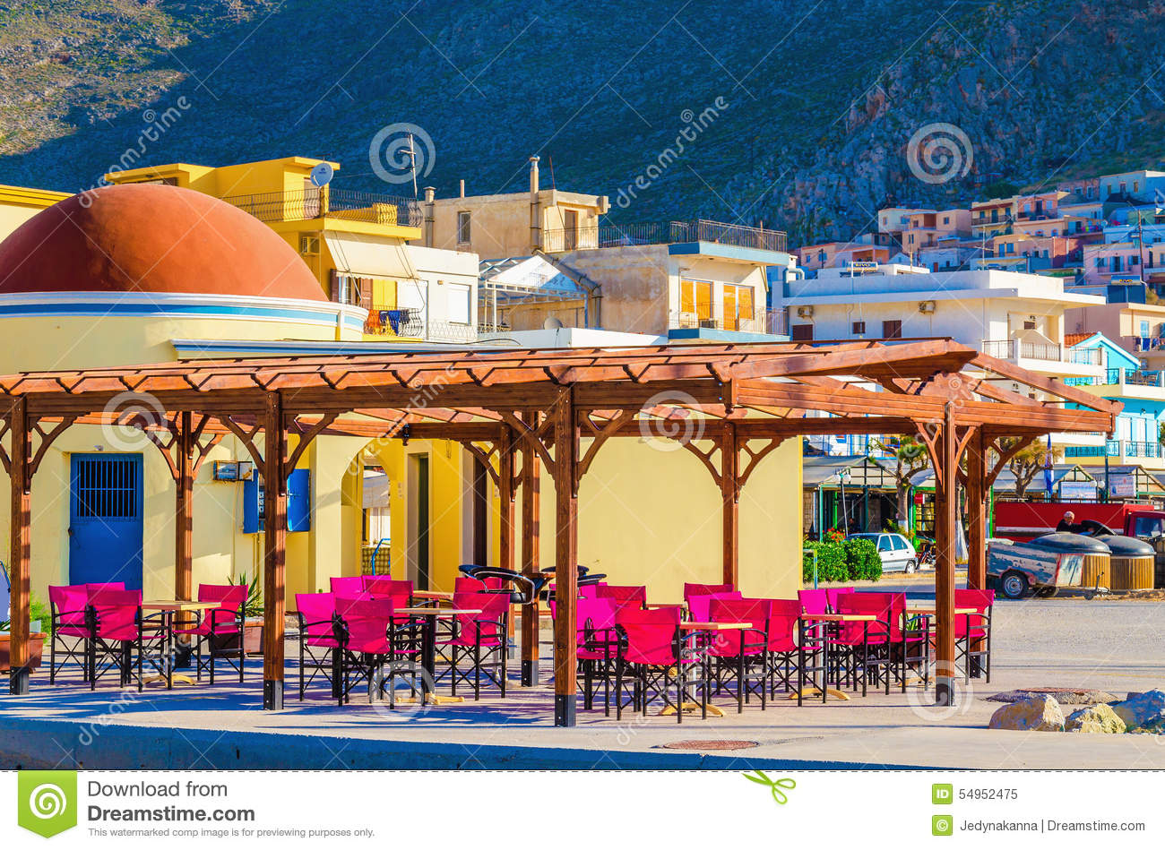 Colorful Restaurant With Red Wooden Chairs Greece