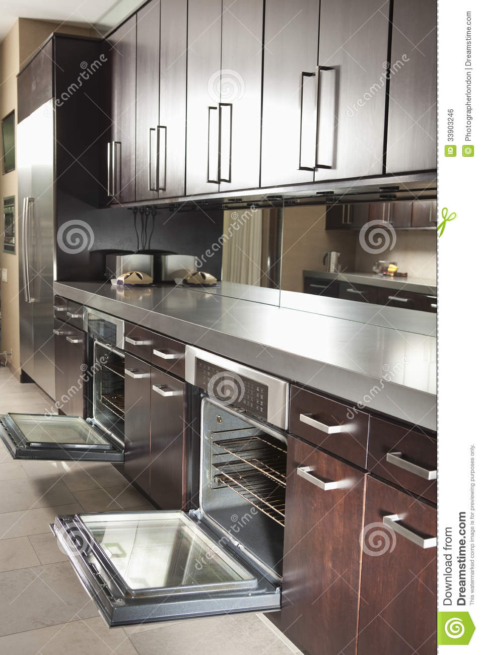 Commercial Kitchen With Open Oven And Cabinets Stock Photo