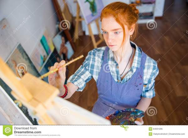 Concentrated Woman Painter Holding Art Palette And