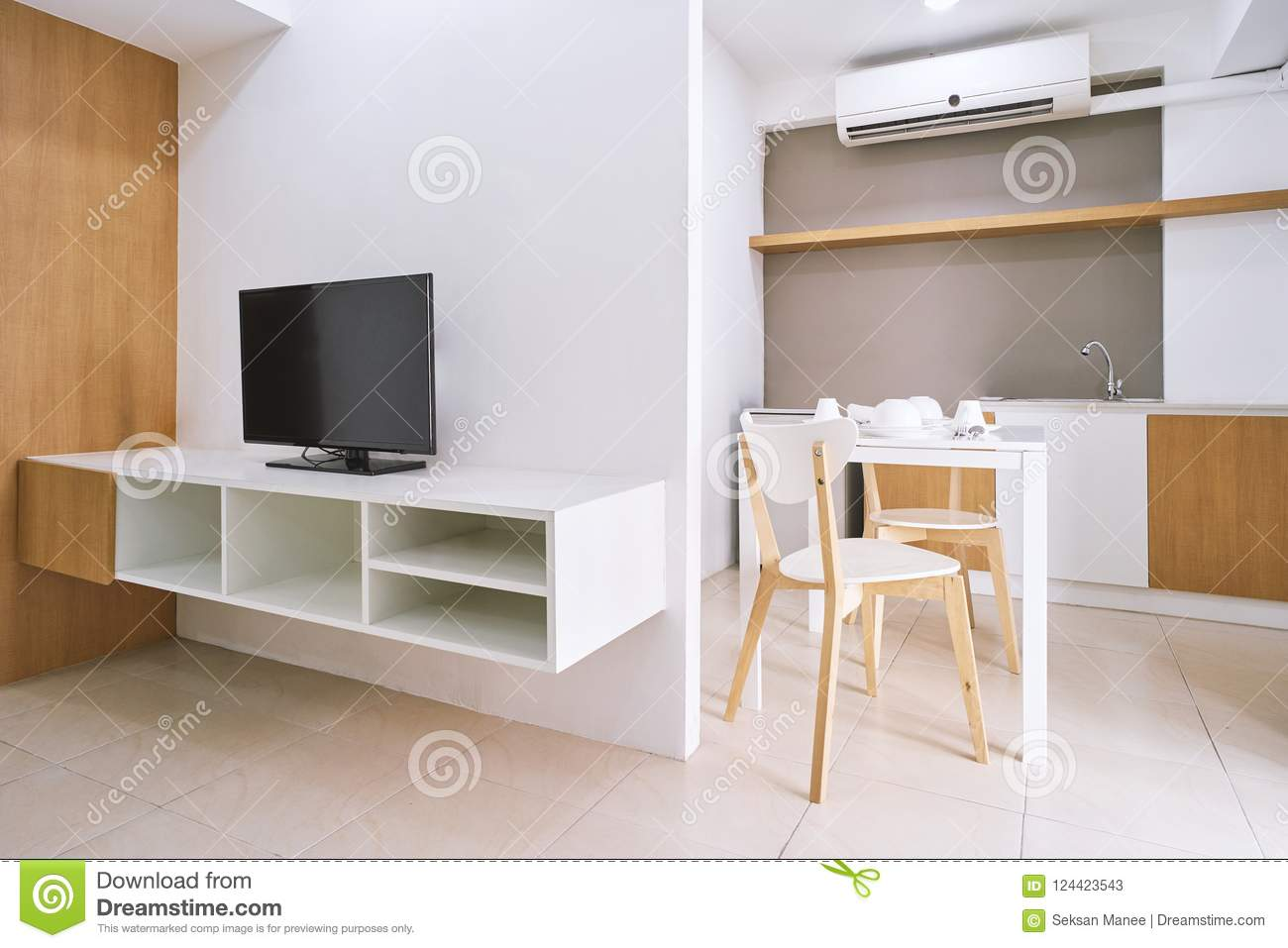 desk in living room apartment simple tv panel design for modern decoration with built furniture and concept of table set chairs mock up the white