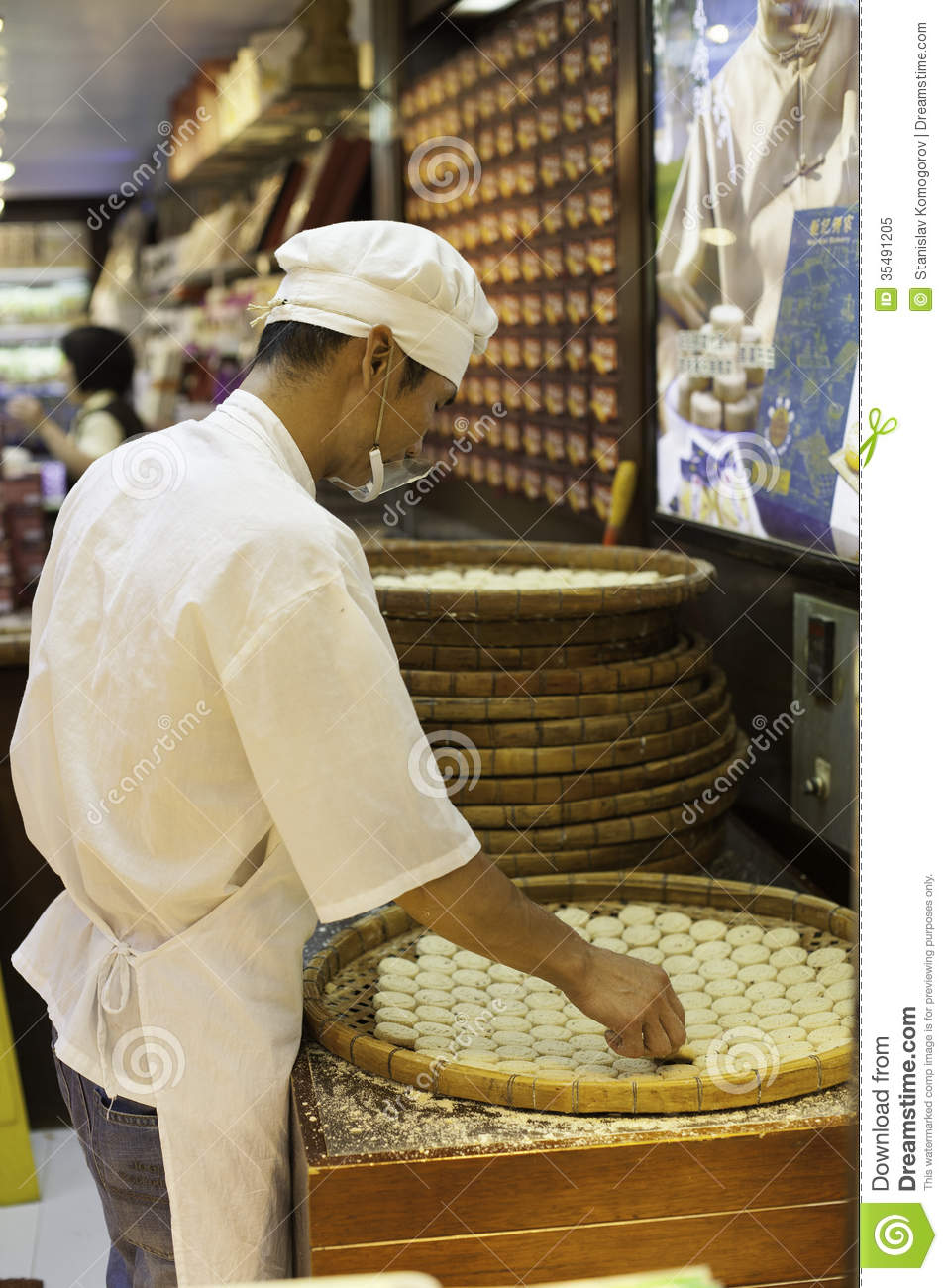 Confectioner Manufactures Biscuits In Candy Store