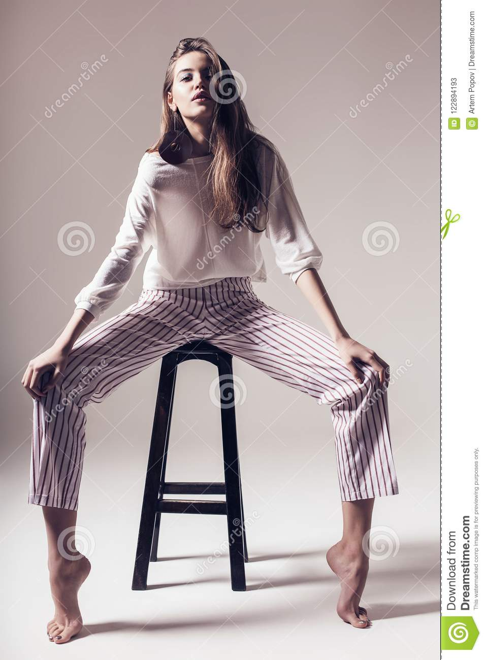 Chair Pants Contemporary Woman In Striped Pants Sitting On Chair Stock Image