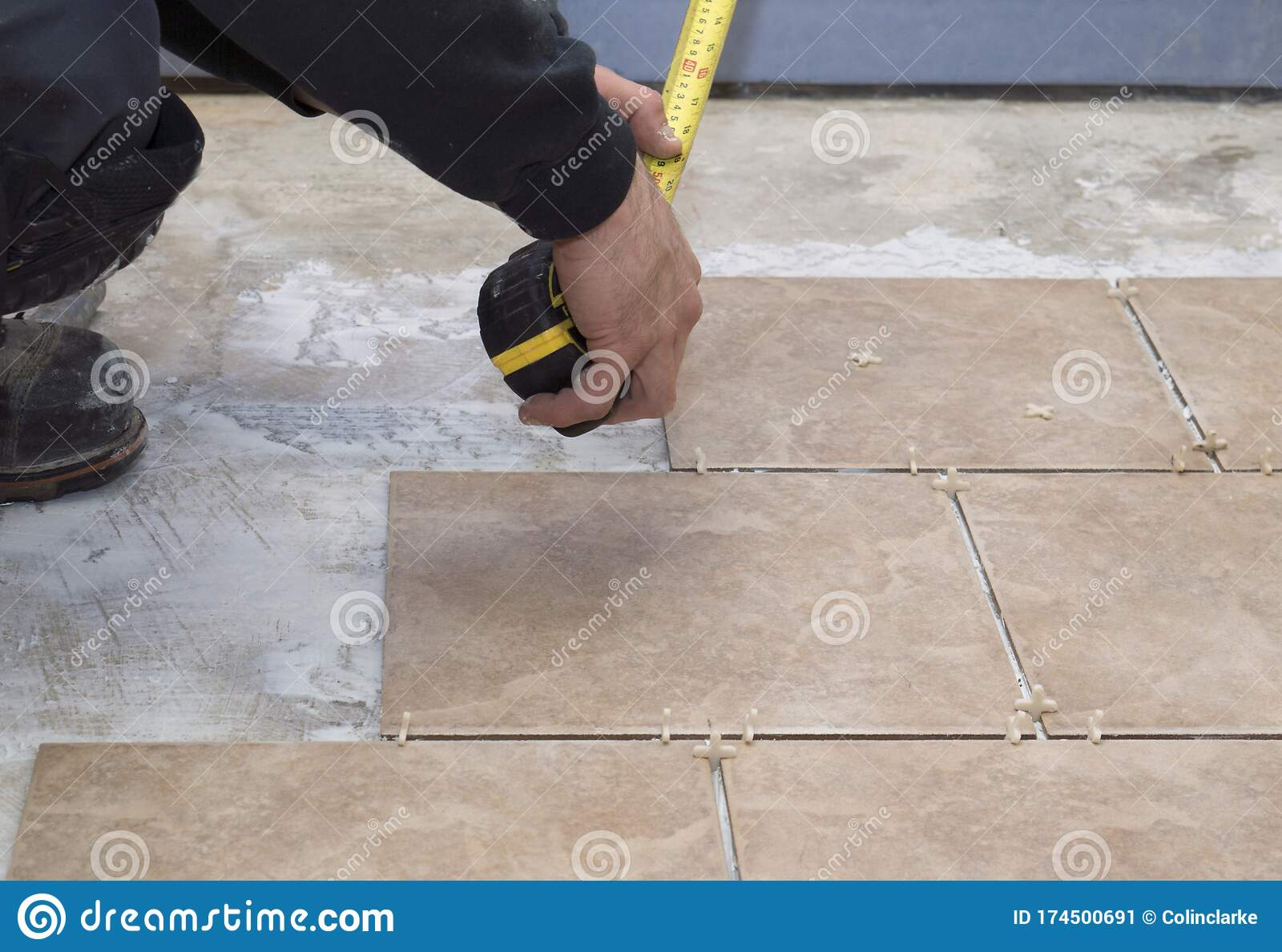 https www dreamstime com contractor handyman installs ceramic tiles measures distance wall to get accurate fit tiling basement image174500691