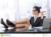 Businesswoman Feet On Desk