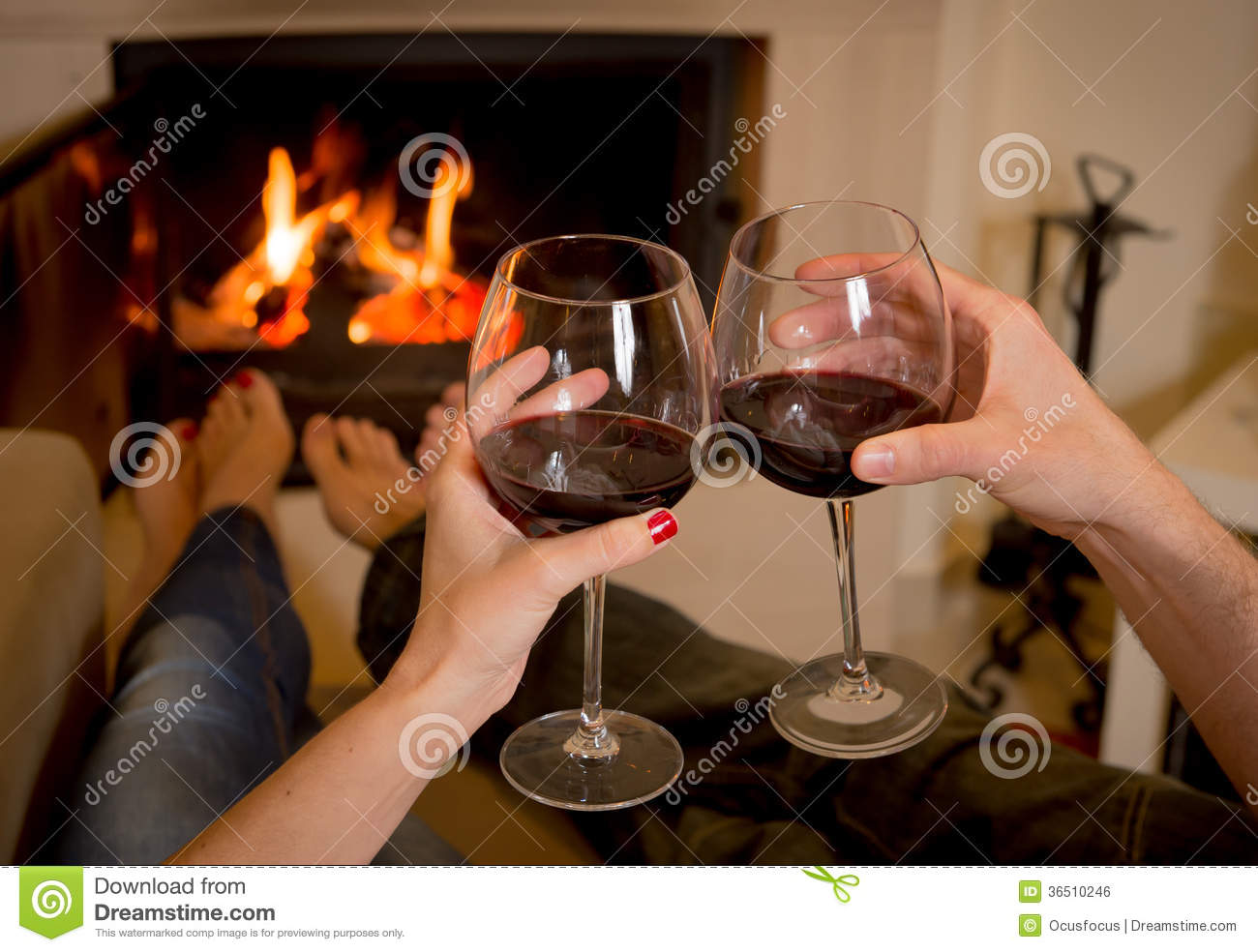 Couple Relaxing In Front Of Fireplace Man Looking At Woman Stock Couple Drinking Wine In Front Of A Fire Royalty Free Stock