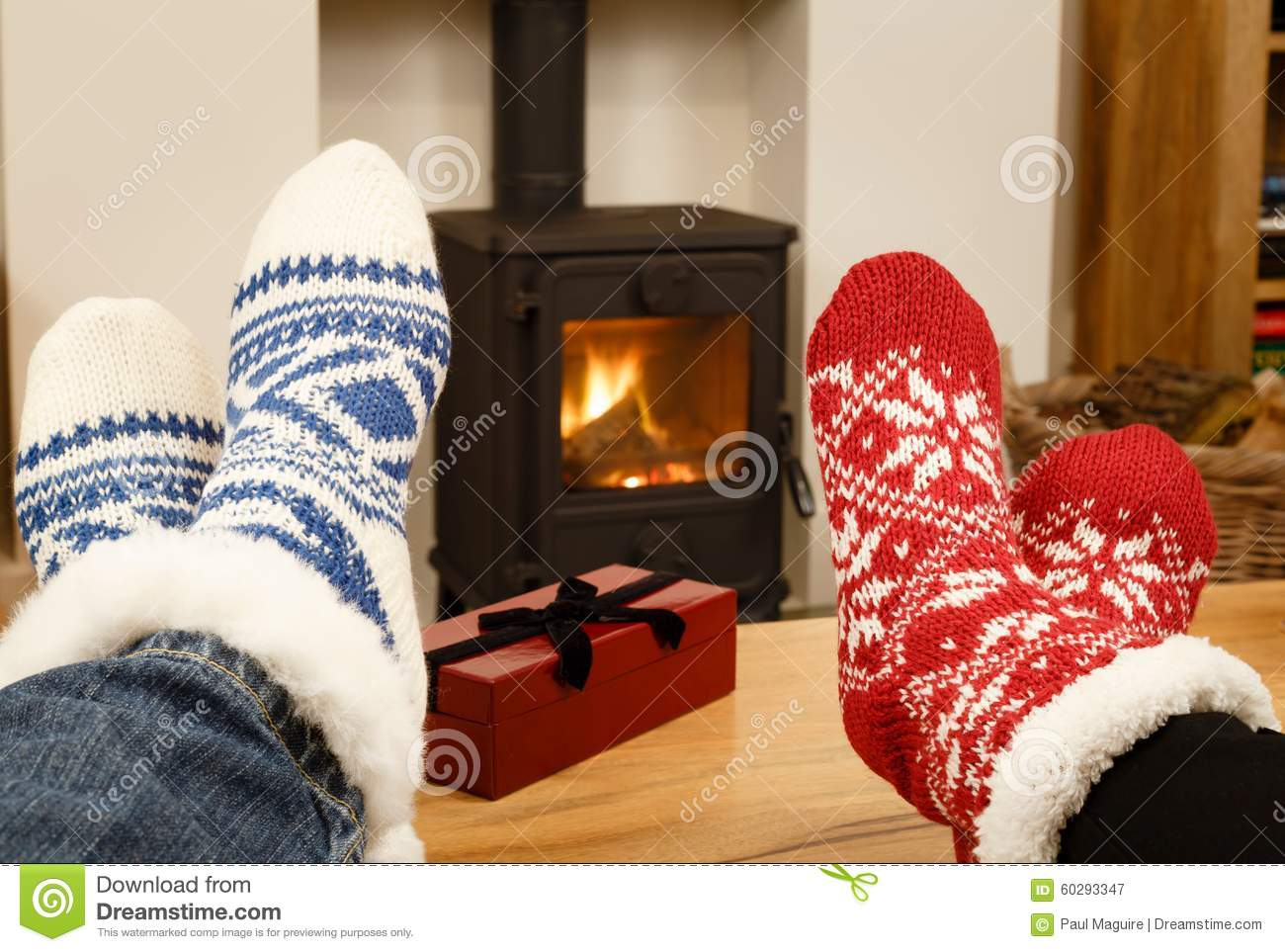 Couple Relaxing In Front Of Fireplace Man Looking At Woman Stock Christmas Couple Feet In Front Of Fire Stock Image - Image