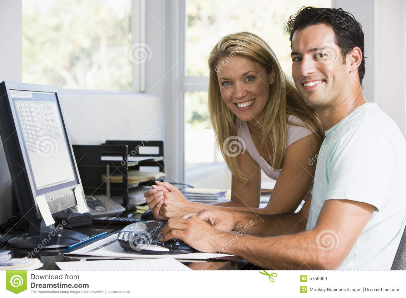 Couple In Home Office With Computer Smiling Royalty Free