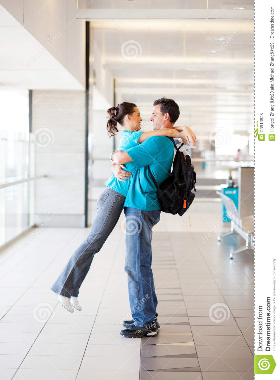Couple Hugging At Airport Royalty Free Stock Photo  Image