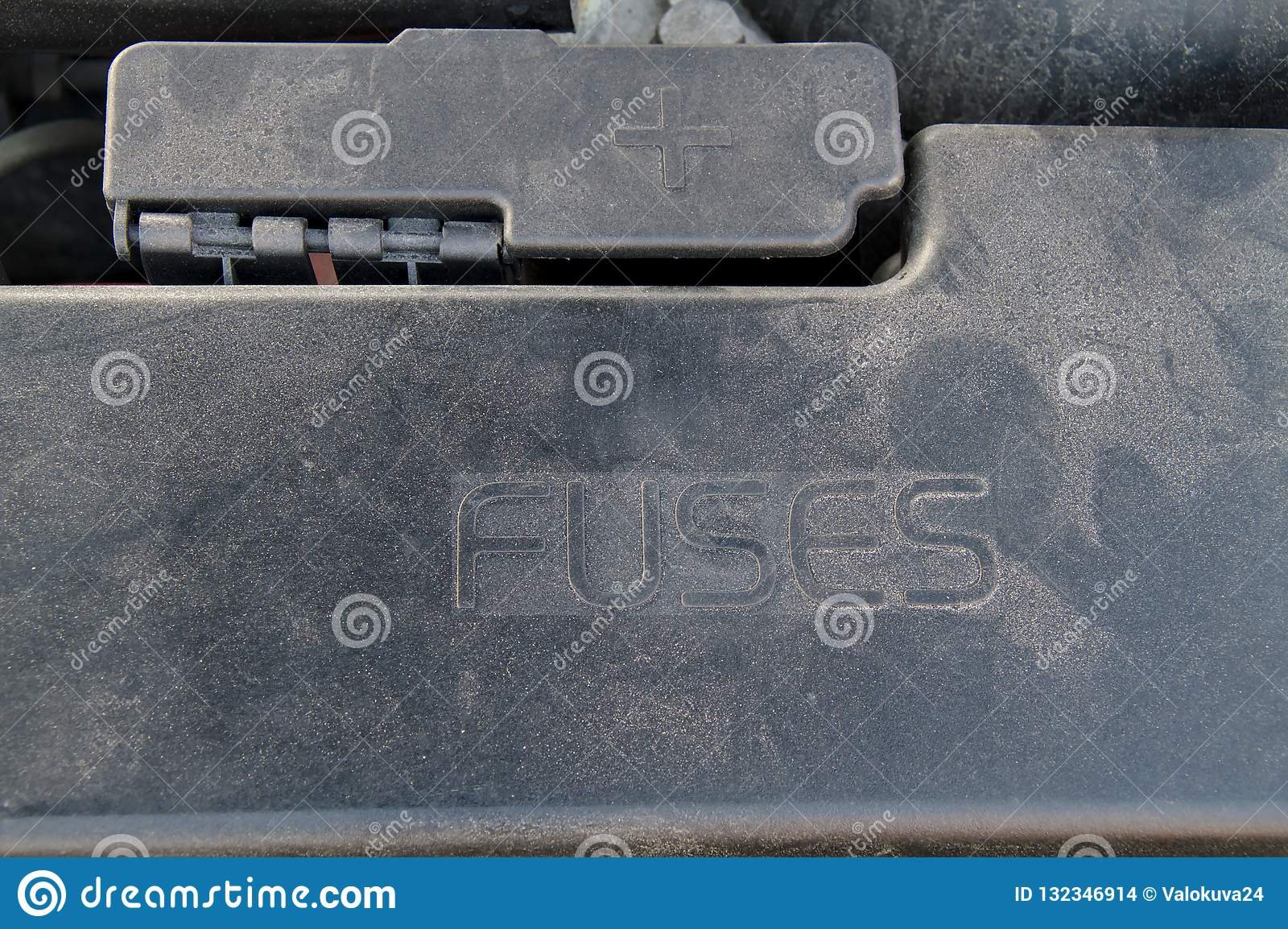 hight resolution of cover of a under hood fuse box of a car external plus terminal for jumper cables next to the fusebox