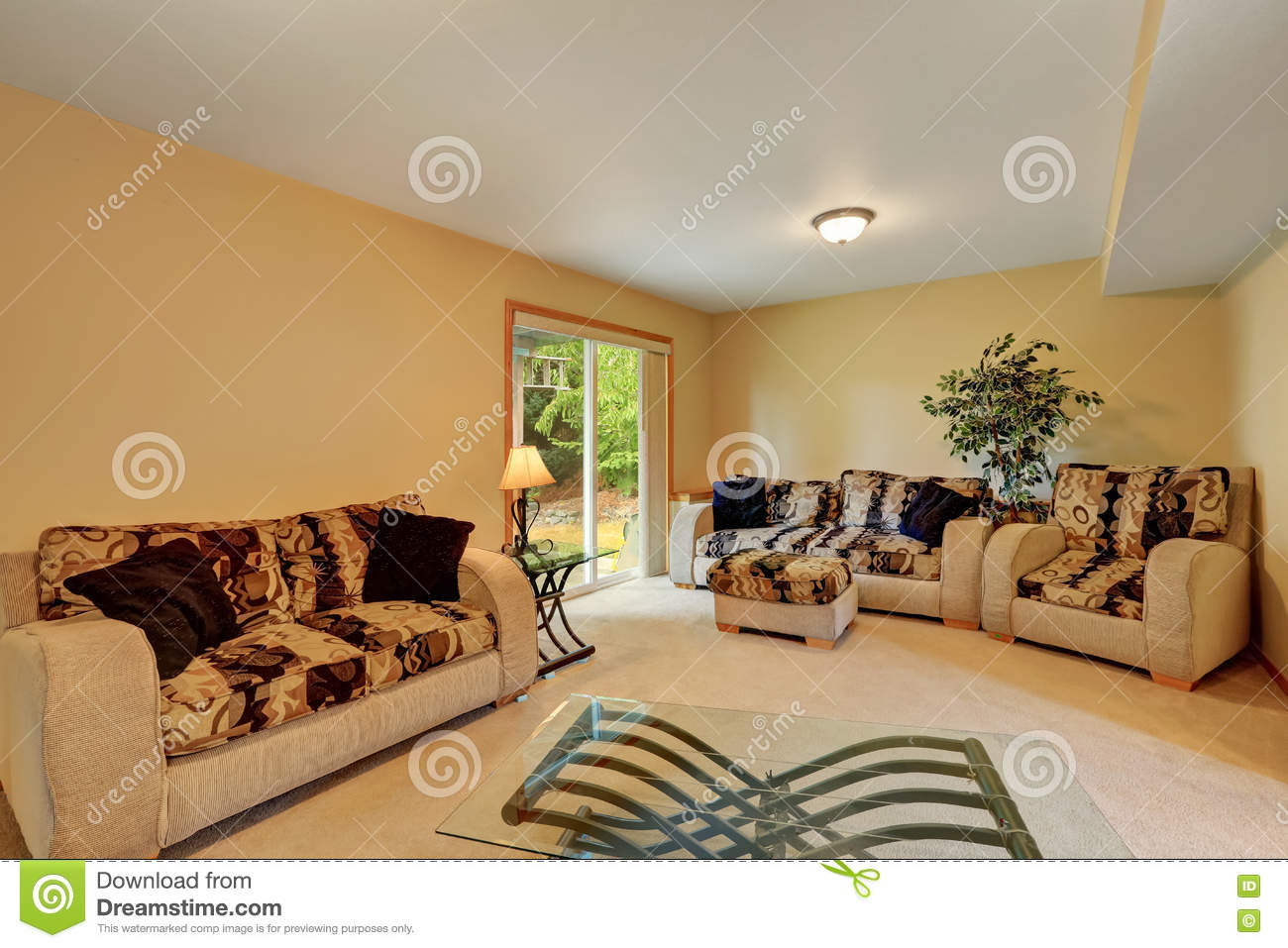 comfortable sofas for family room flexsteel reclining fabric cozy in warm peach and beige tones stock image sofa set with colorful cushions modern glass coffee table doors to backyard northwest usa