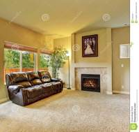Cozy Living Room With Carpet, And Fireplace. Stock Photo