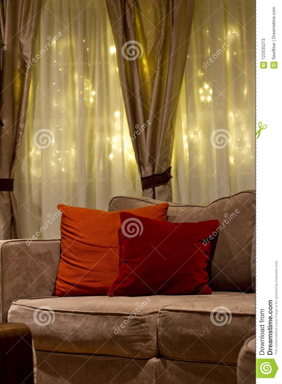 throw pillows for living room couch paint color rooms cozy nighttime stock image of indoors a with orange and red against curtains lights