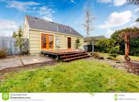 Cozy Olive And Orange House With Backyard Deck. Stock ...