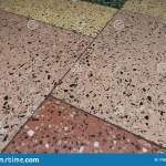 Cracks In The Concrete Floor With Granite Chips Large Differently Colored Floor Tiles Separated By Thin Lines Stock Image Image Of Design Closeup 176961963