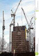 Cranes surrounding a building