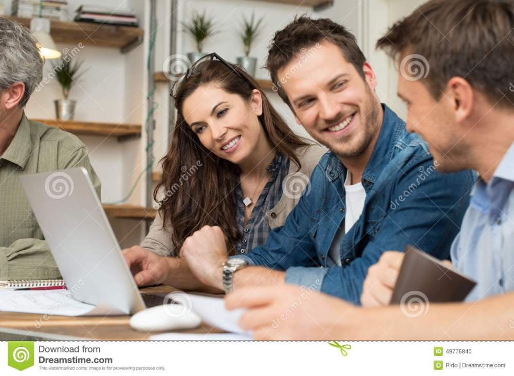 medium resolution of creative professionals working stock photo