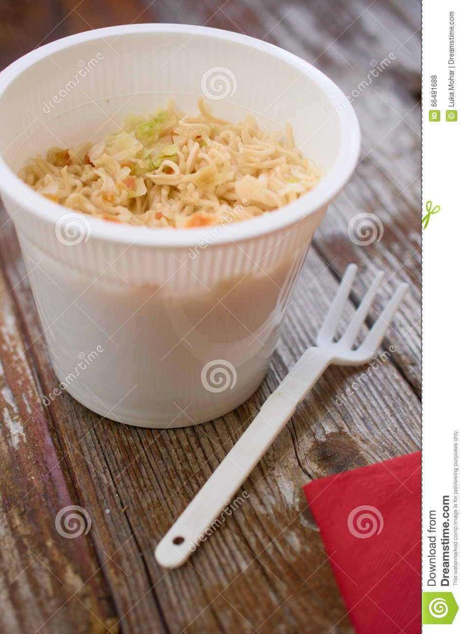 Cupanoodles Pasta Ramen In Plastic Cup On Wood Table