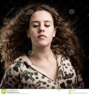 curly ginger teenage woman in