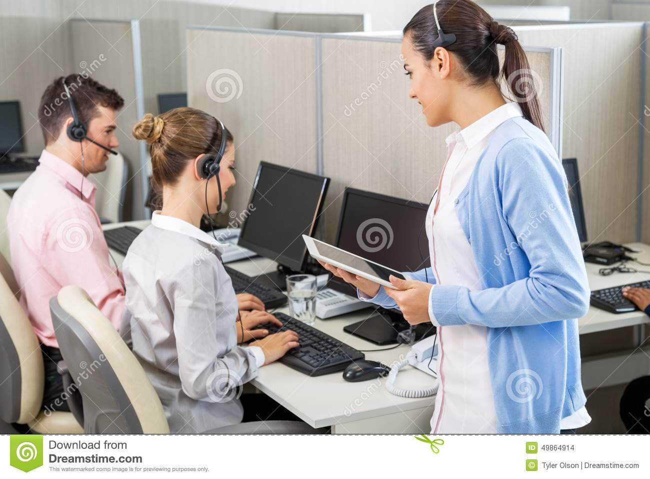 Customer Service Executive Talking To Colleagues Stock Photo  Image 49864914