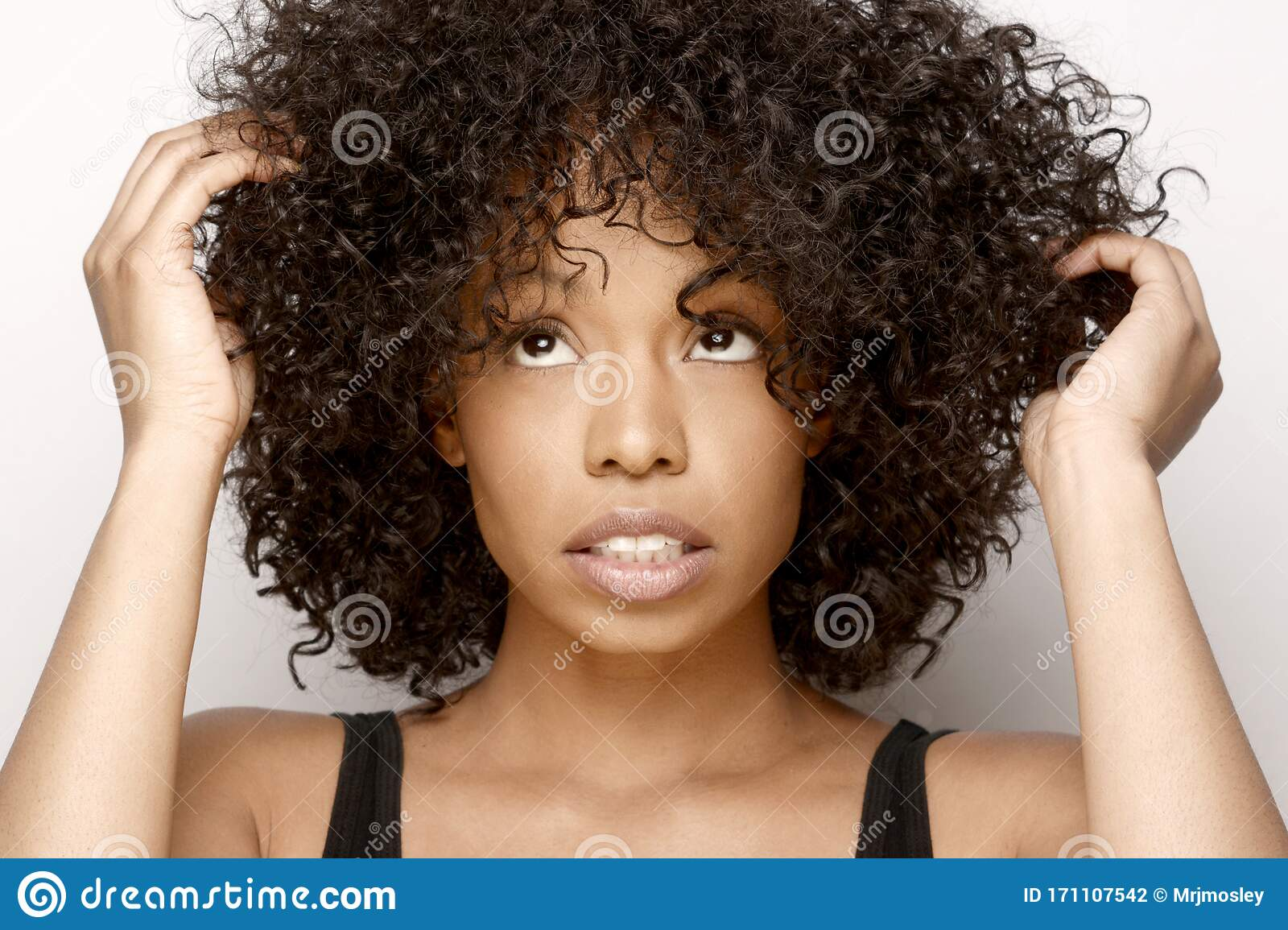 Cute African American Woman In Need Of Some Natural Hair Care