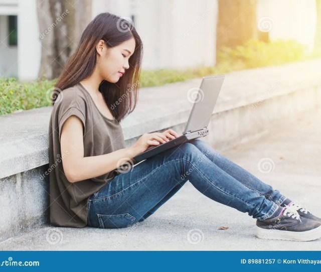 Cute Asian Teen Women Student Using Laptop Computer
