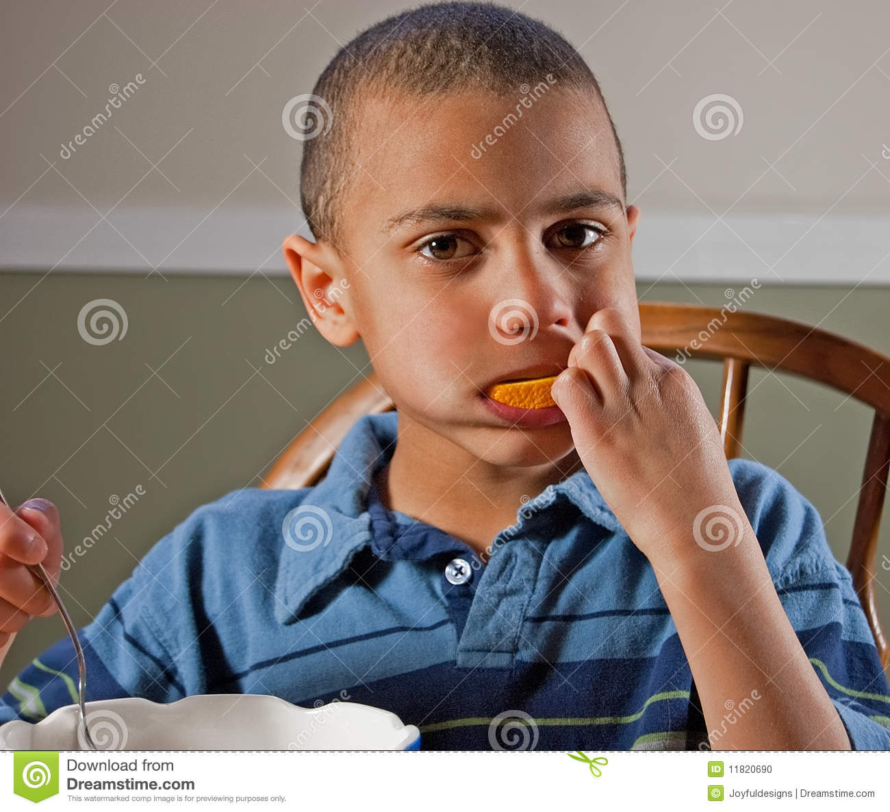Cute BiRacial Boy Eating Orange Stock Photo  Image 11820690