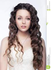 cute brunette young girl with curly