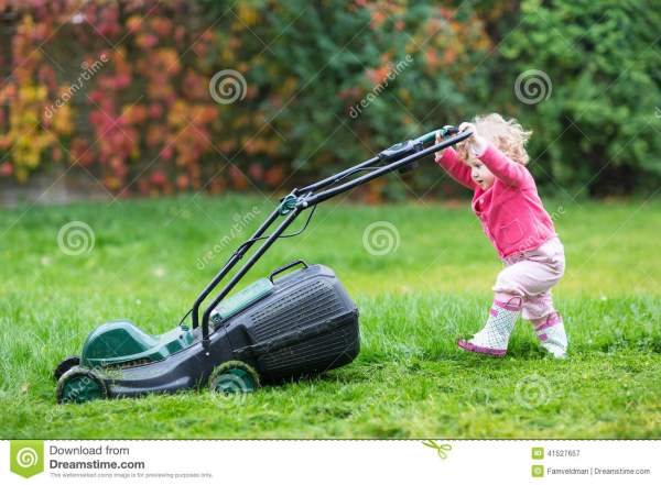 cute curly baby girl with lawn
