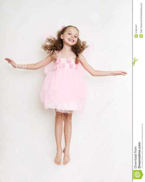 Cute Girl In Fairy Costume Jumping In The Studio Stock