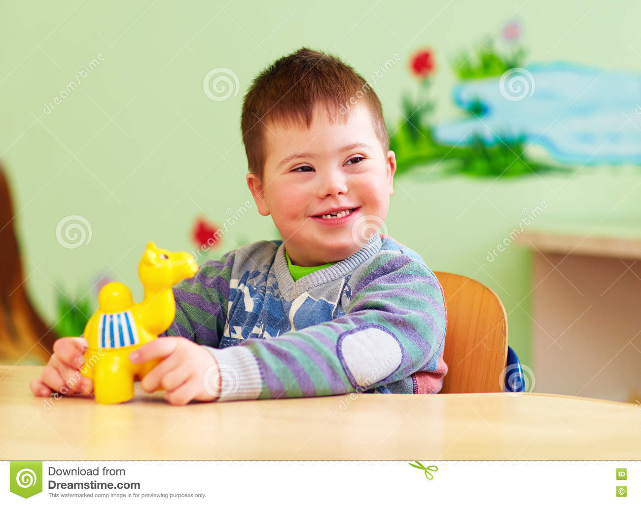 Cute Kid With Down S Syndrome Playing In Kindergarten